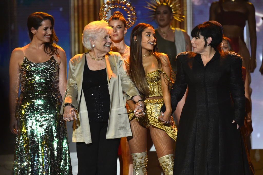 Ariana Grande on stage with her grandma, mom, and aunt