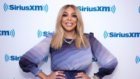 Wendy Williams wearing purple at an event