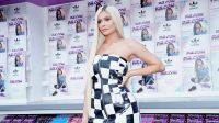 Kylie Jenner wearing a black and white checkered dress