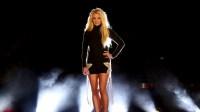 Britney Spears wearing a black dress