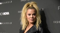 Khloe Kardashian wearing a high ponytail with a black outfit