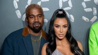 Kim Kardashian wearing a silver dress with Kanye West