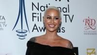 Amber Rose wearing a black dress at an event
