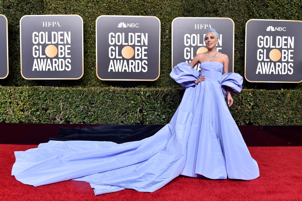 Lady Gaga wearing a huge purple dress at the Golden Globes
