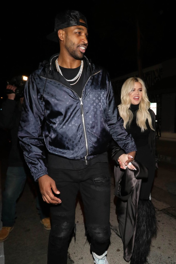 Tristan Thompson wearing a jacket with Khloe Kardashian holding hands
