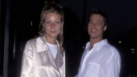 Brad Pitt wearing a white shirt with Gwyneth Paltrow wearing a silk shirt