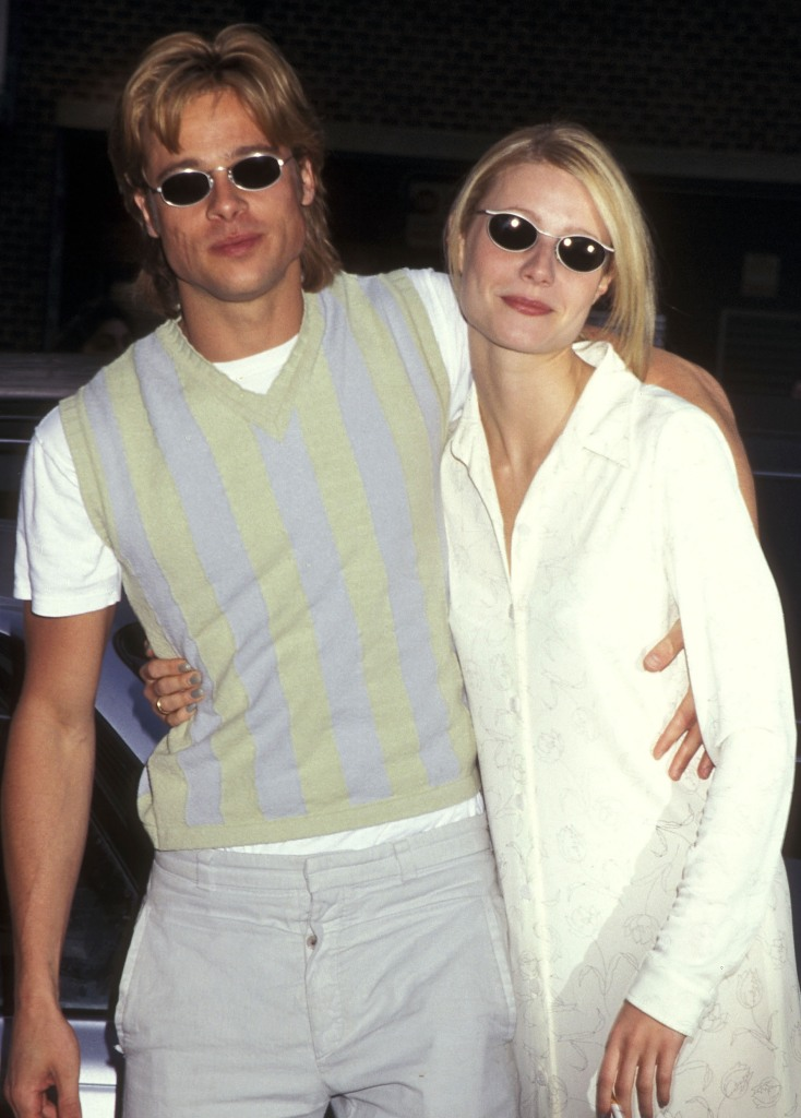 Gwyneth Paltrow wearing a white outfit, Brad Pitt wearing a vest with sunglasses