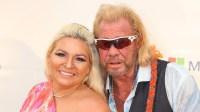 Beth Chapman wearing a pink dress with Dog Duane Chapman wearing sunglasses