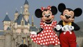 Mickey and Minnie Mouse are seen in front of the Sleeping Beauty Castle at the new Disneyland Park on September 1, 2005 in Hong Kong.