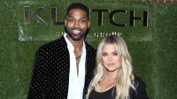 Khloe Kardashian wearing a black outfit with Tristan Thompson