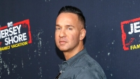 The Situation wearing a blue shirt at an event