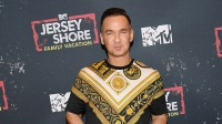 Mike 'The Situation' Sorrentino wearing a yellow and black shirt