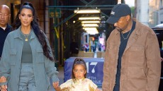 Kim Kardashian wearing a blue outfit with North and Kanye West