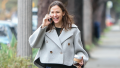Jennifer Garner walking and smiling with a grey coat on