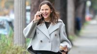 Jennifer Garner walking and smiling with a grey coat on