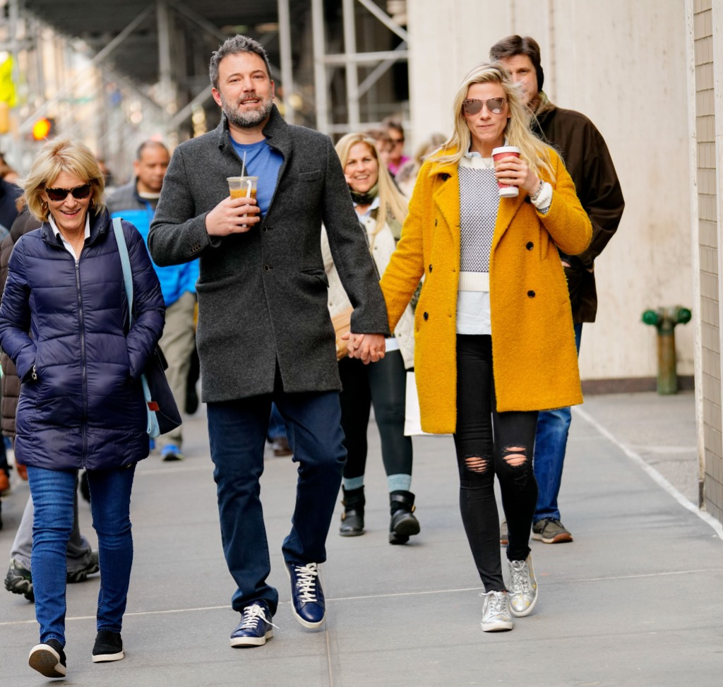 Ben Affleck and Lindsay Shookus holding hands and drinking coffee in NYC