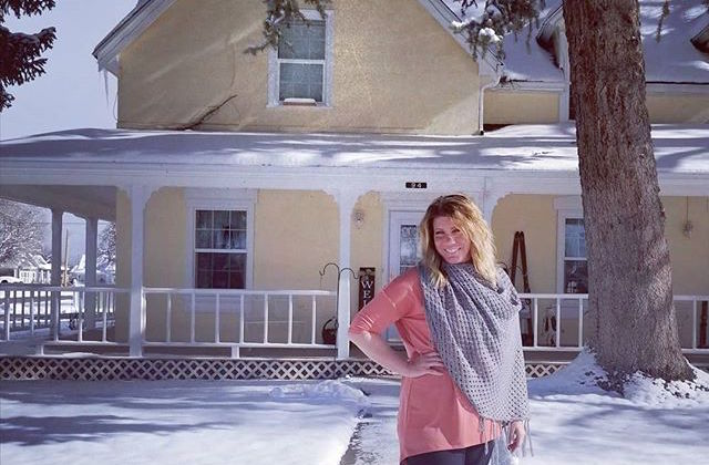 Meri Brown In Front Of Her Bed And Breakfast