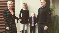 Pink And Carey Hart Stand With Children Outsdie Home