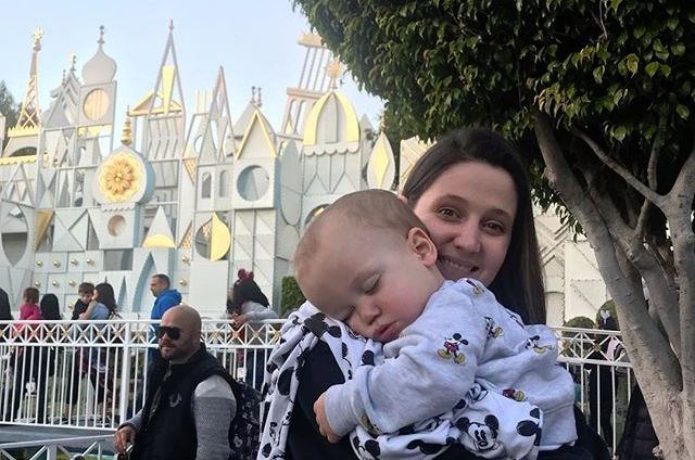 Tori Roloff Holds Sleeping Jackson At Disneyland