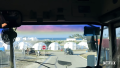 View of Disaster Relief Tents At Fyre Festival Through School Bus Window