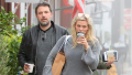 Ben Affleck and Lindsay Shookus walking and drinking coffee