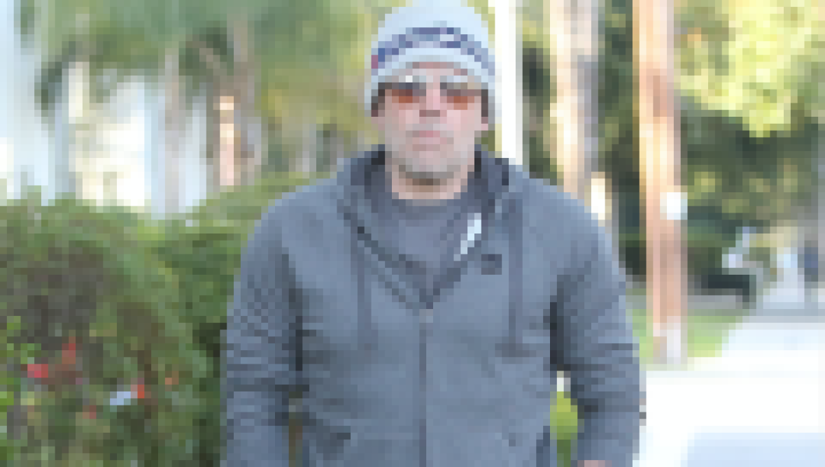 Ben Affleck walking in L.A. wearing a grey hoodie, grey sweatpants and Patriots beanie