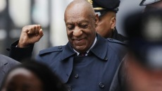 Bill Cosby Raises Fist Outside of His Trial
