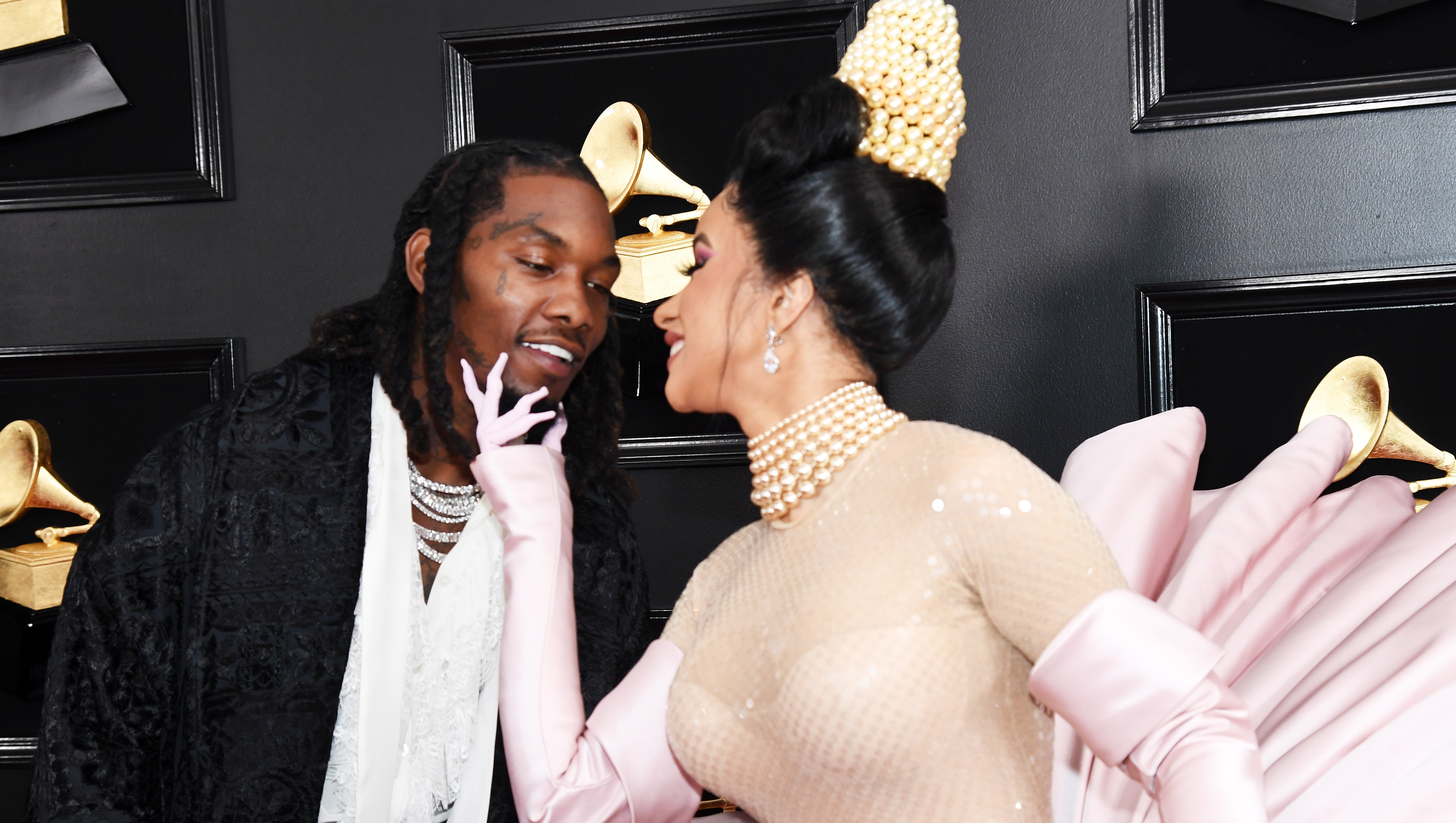Cardi B and Offset kissing at the 2019 Grammy Awards