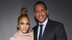 J.Lo with a top knot with Alex Rodriguez wearing a suit