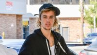 Justin Bieber wearing a black hoodie and hat
