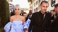 Lady Gaga holding hands with Christian Carino at the Globes