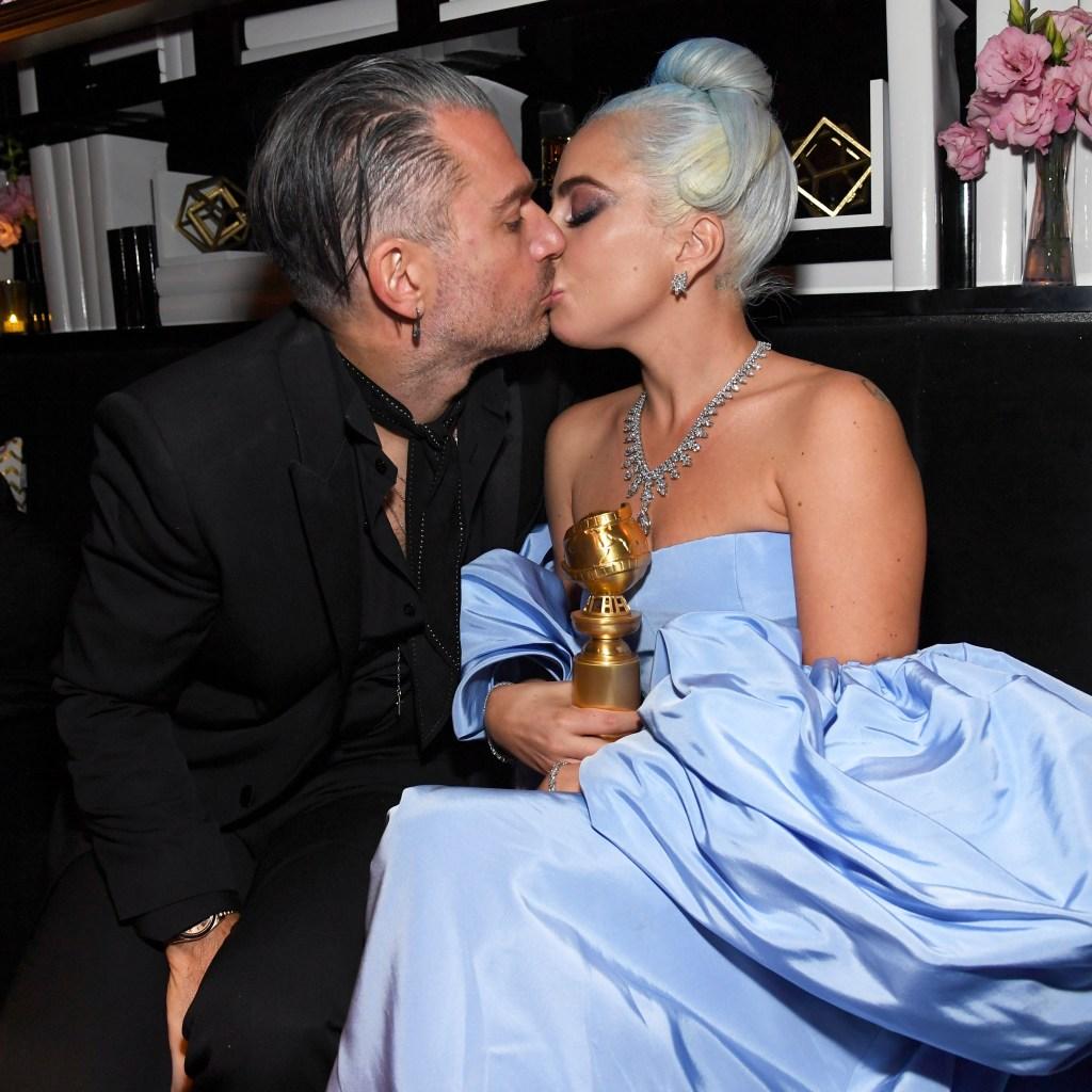 Lady Gaga kissing Christian Carino