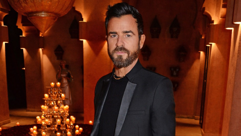 Justin Theroux wearing a black suit at an event