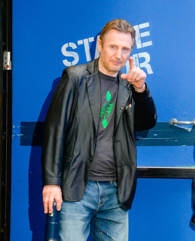 Liam Neeson wearing a black jacket in NYC