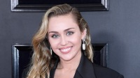 Miley Cyrus wears a black pantsuit at the Grammys