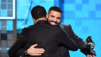 Drake hugging at the Grammy Awards