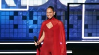 Alicia Keys wearing a red dress at the Grammys