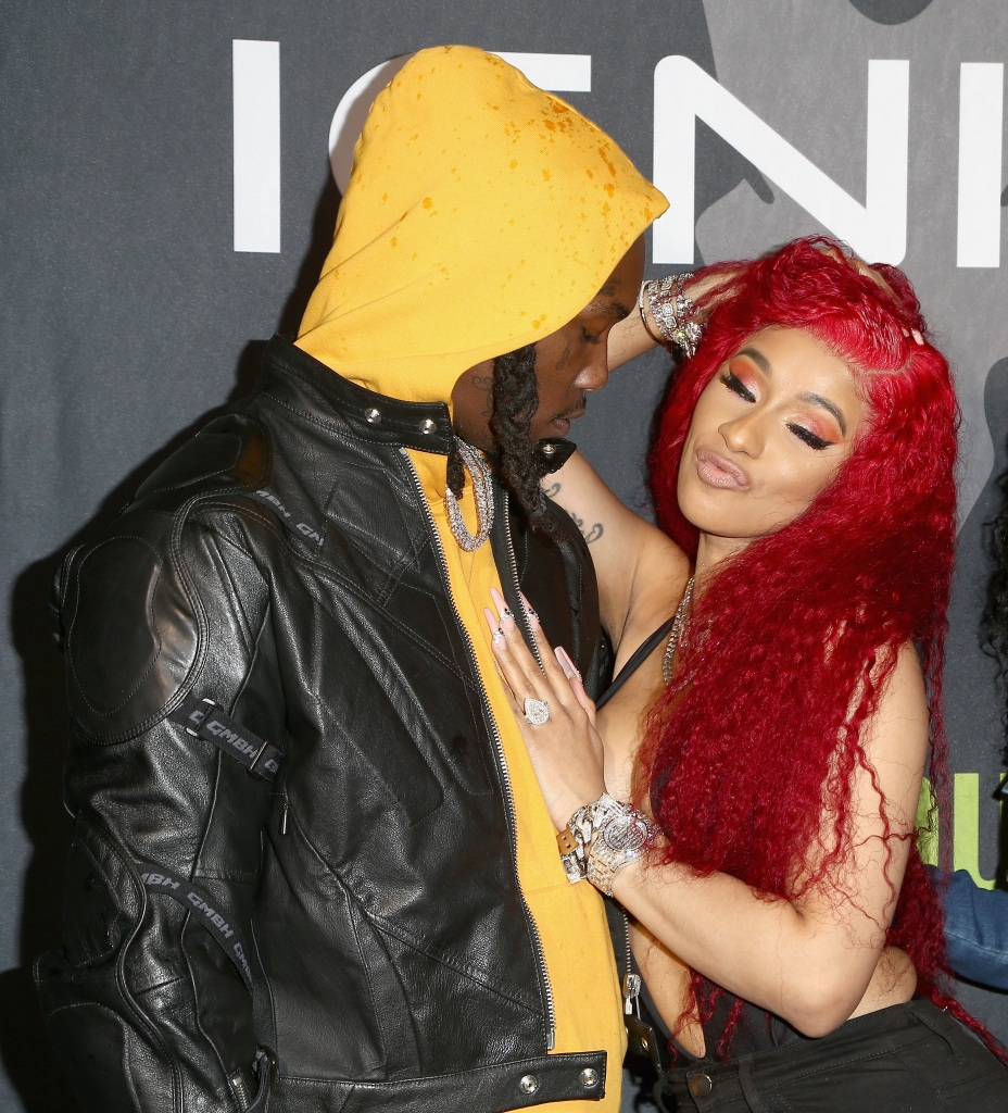 Cardi B with red hair with Offset in a yellow sweatshirt