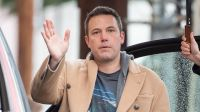 Ben Affleck waving in a trench coat in California