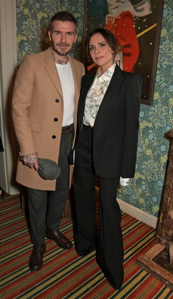 Victoria Beckham wearing a black jacket with David Beckham