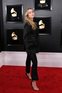 Miley Cyrus wearing black pantsuit at Grammys