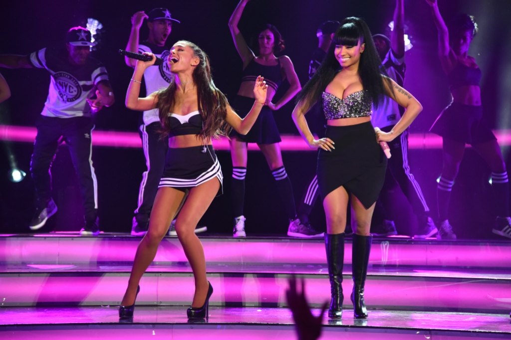 Ariana Grande and Nicki Minaj on stage performing wearing all black
