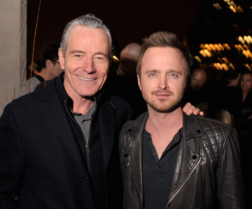 Bryan Cranston with Aaron Paul at an event, wearing all black