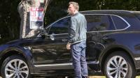 Ben Affleck smoking near a car