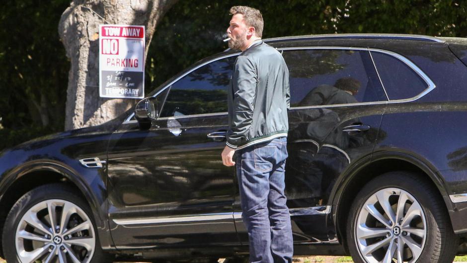 Ben Affleck smoking near a car