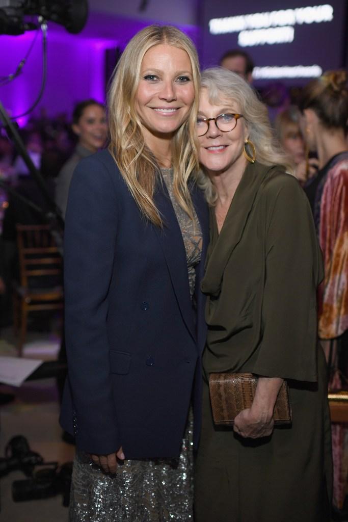 Gwyneth Paltrow wearing a blue jacket with mom Blythe Danner