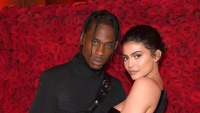 Kylie Jenner and Travis Scott with a rose flower background