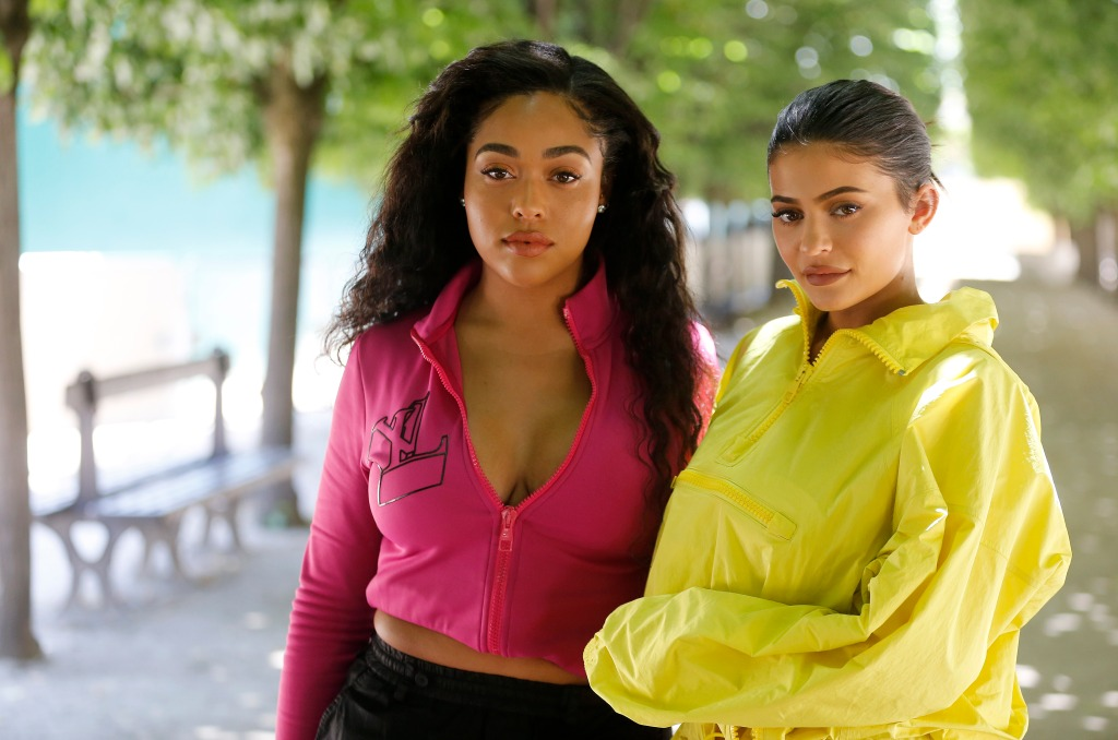 Kylie Jenner wearing yellow with Jordyn Woods wearing pink
