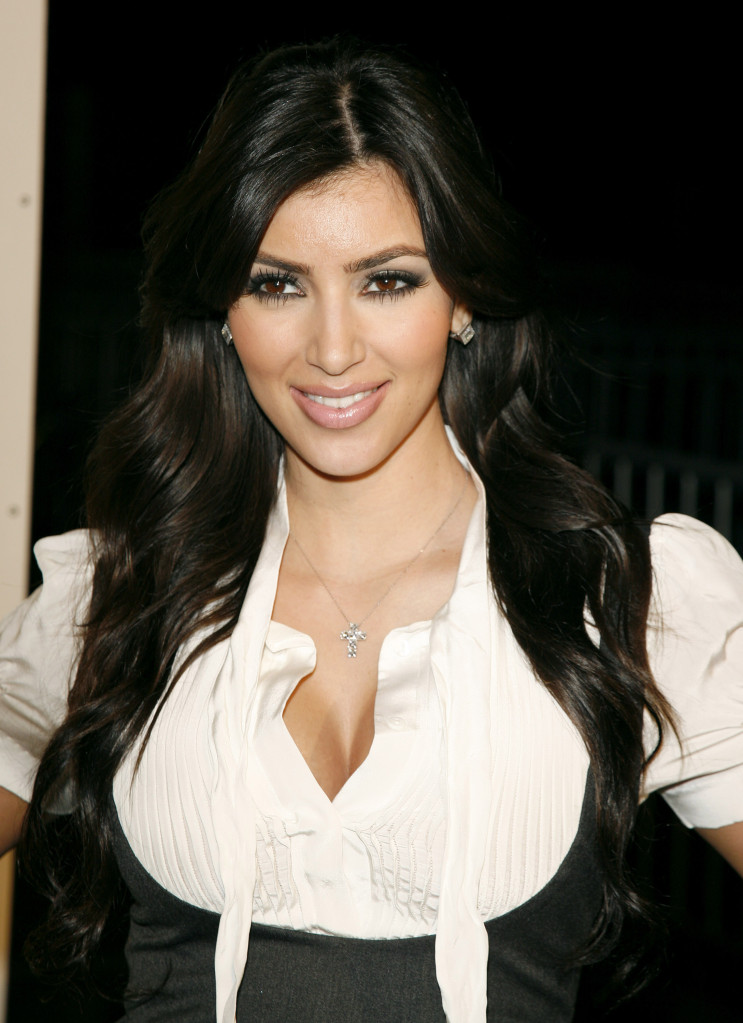 Kim Kardashian in 2007 wearing a white top and black vest