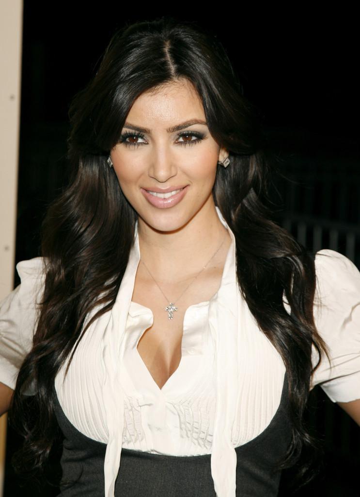 Kim Kardashian in 2007 wearing a white top and black vest